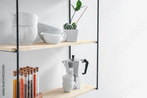 Modern shelf on wall in kitchen