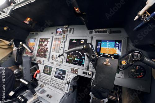 Billede på lærred Different displays. Close up focused view of airplane cockpit
