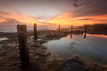 Soft Diffused Sunrise Light At Coastal Rock Pool