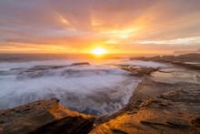 Sunrays Burst Forth From Sunrise Sun On Beautiful Coastline