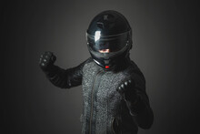 An Angry Aggressive Motorbiker Is Shaking By His Fist Concept.