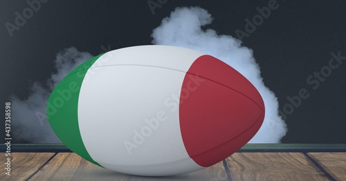 Compostion of rugby ball of italy flag on black background with white smoke