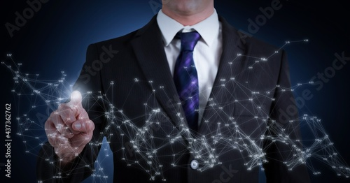 Composition of businessman touching screen with network of connections