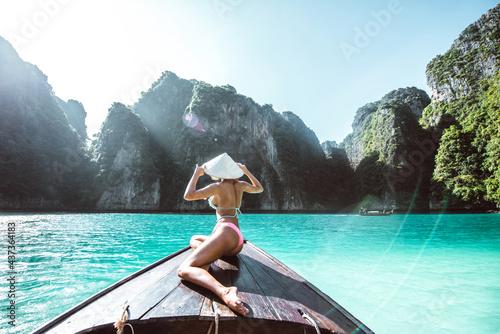 Fototapeta Beautiful woman making an excursion to phi phi island and maya beach in Thailand