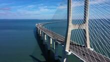 Aerial View Of Traffic On The Vasco Da Gama Bridge, In Lisbon - Reverse, Drone Shot