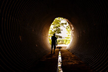Coming Out Of The Tunnel, A Man Walks Towards The Light.