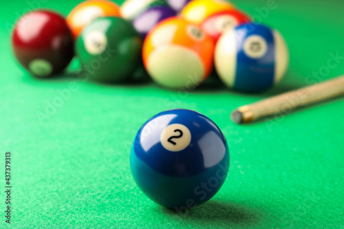 Canvas Print Billiard ball with number 2 on green table, closeup