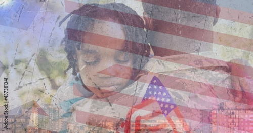 Composition of male soldier embracing son over american flag