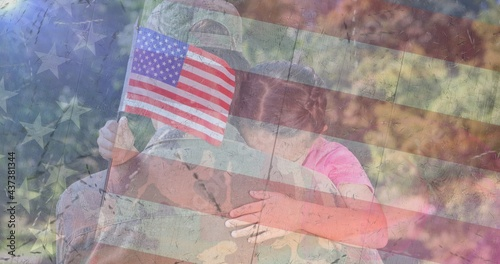 Composition of male soldier embracing daughter over american flag