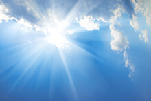 Beautiful Blue Sky With Sunbeams And Clouds. Sun Rays From Cloud