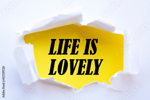 Life is Lovely. Words written under torn paper. Motivation concept text.