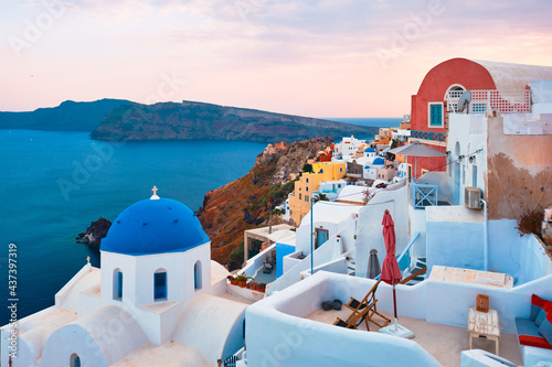 Fototapeta Famous view from viewpoint of Santorini Oia village with blue dome of greek orth