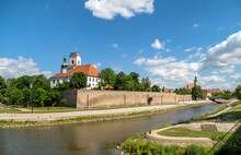 View Of Gyor Downtown With The Bishops Castle And Cathedral Tower By The Raba River.Hungary.