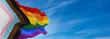 canvas print picture - Progress LGBTQ rainbow flag waving in the wind at cloudy sky. Freedom and love concept. Pride month. activism, community and freedom Concept. Copy space. 3d illustration
