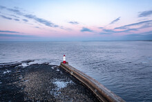 A Lighthouse And Breakwater At The Mouth Of A Berwick Upon Tweed