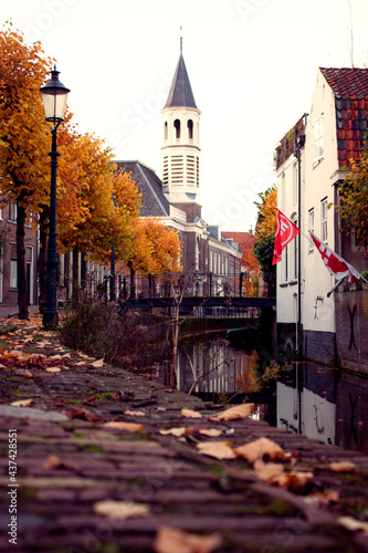 Foto Church tower at canal