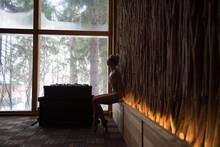 Girl In A Swimsuit In A Sauna