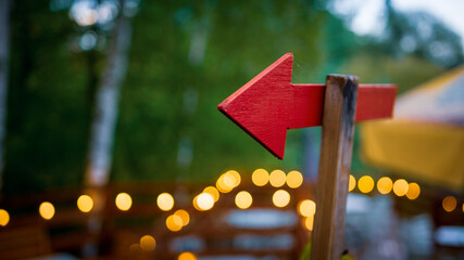 red signpost arrow bokeh background