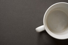 Empty, Unwashed White Mug Or Cup On A Dark Grey Background - Photographed From Above In A Flat Lay Style