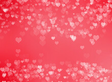 Abstract Bokeh Background With Hearts Patten On Red Colour.