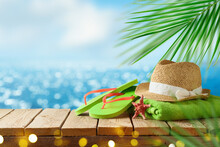 Tropical Summer Concept With Beach Accessories On Wooden Board Over Sea Beach Background. Holidays Vacation Concept