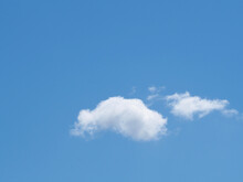 Small And Large Cloud Against The Blue Sky. Blue Background
