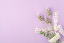 Purple Lavender Flowers On Pink Background With Lace Ribbon