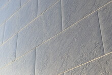 Grey Ceramic Tiles On The Wall Of The House