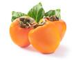 Leinwandbild Motiv Three ripe juicy persimmons with green leaves isolated on white background