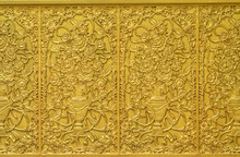 Image Of Golden Flowers With Flowerpots On Metallic Wall. It Constructed With Metal And Painted Gold Color.