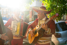 Musicians On The City Street At Sunset. Latin American Music.