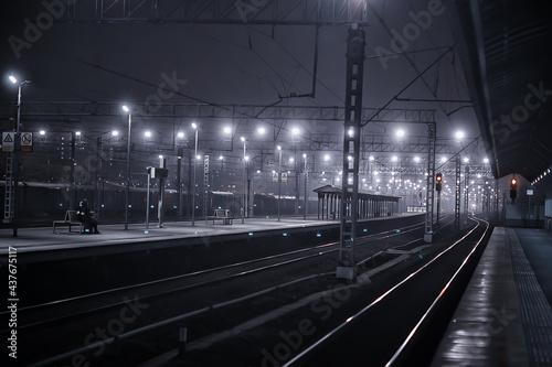 Obraz na plátně railway tracks night landscape at the railway station fog autumn