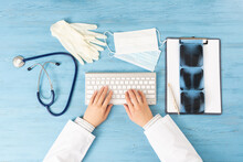 Top View Of Doctor Hands Holding Pen