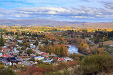 The Town Of Clyde, New Zealand, In Autumn. The Clutha River Passes Through The Town At Center Right