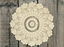 Beautiful Crochet Doily On Old Wooden Background