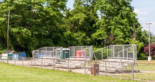 Empty Metal Bleacher Seats Next To A Football Field In Swissvale, Pennsylvania, USA On A Sunny Summer Day
