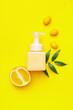 Leinwandbild Motiv Bottle of natural cosmetics with citrus fruits on color background