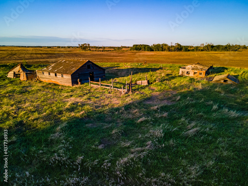 Canvastavla An aerial view of an old farm yard that has been abandoned, forgotten, and left to be reclaimed by nature