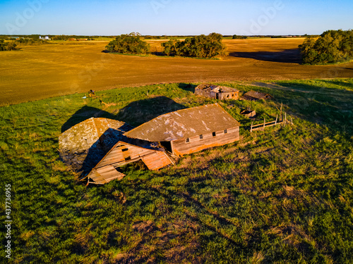 An aerial view of an old farm yard that has been abandoned, forgotten, and left to be reclaimed by nature Fototapet