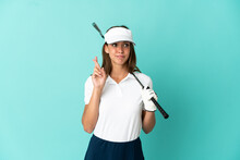 Woman Playing Golf Over Isolated Blue Background With Fingers Crossing And Wishing The Best