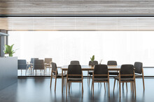 Modern Office Interior With Long Dining Tables And Gray Chairs