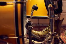 Part Of Leg Of Drummer On Pedal Of Drum Kit In Studio