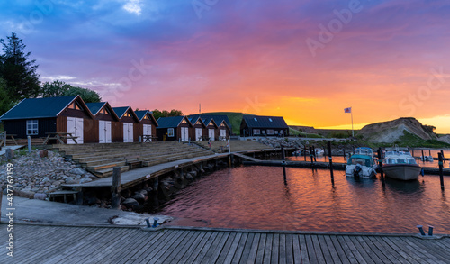 Fotografie, Obraz colorful sunset over the small marina and harbor at Ejerslev Lynd in northern Ju