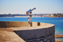 Touristic Telescope On The Fortress Wall Surrounding Saint-Malo Intra-Muros In Saint-Malo, France