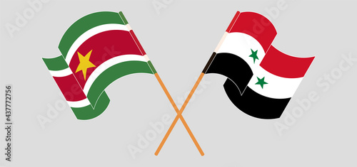 Fotografia Crossed flags of Suriname and Syria