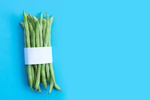 Green Beans On Blue Background.