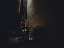 Woman In Dark Room Sitting On Chair Silhouette Model Naked Legs Design