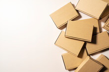 Cardboard Boxes Placed On A Beige Background.
