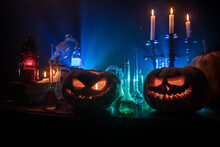 Halloween Still-life Background With Different Elements On Dark Toned Foggy Background. Selective Focus