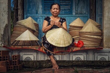 Vietnamese Old Woman Craftsman Making The Traditional Vietnam Hat In The Old Traditional House In Ap Thoi Phuoc Village, Hochiminh City, Vietnam, Traditional Artist Concept